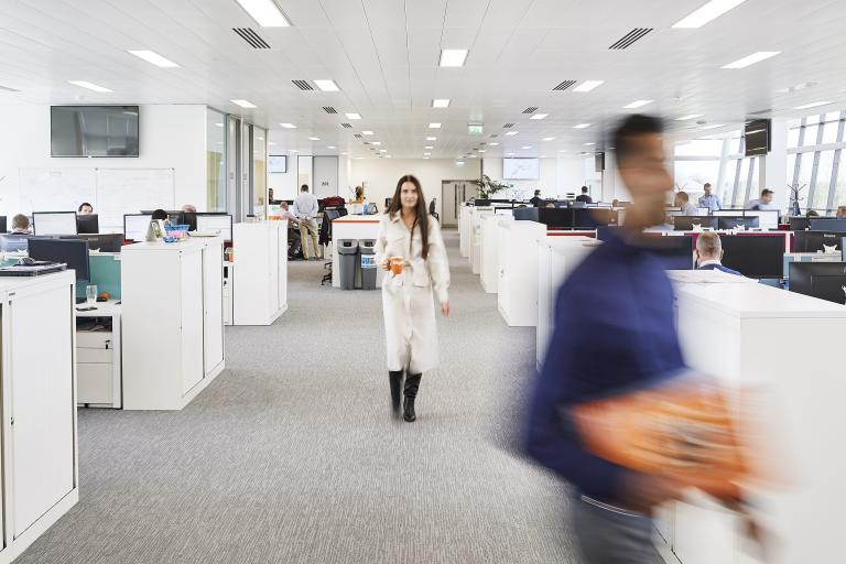 Blurry staff in office